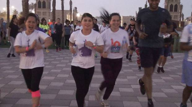 Members of the Runmadan challenge in Dubai prepare for their run.