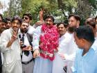 PTI candidate Malik Ahmad Hassan Deher arrives to submit his nomination papers for the 2018 general elections, which will be held on July 25.