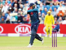 Ton-up Roy happy to knuckle down for England