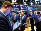 Traders at the New York Stock Exchange. Market jitters are expected after the US president said he will push ahead with tariffs on $50 billion worth of Chinese goods.