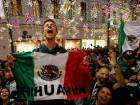 Mexico's fans celebrate victory of their team after the match.