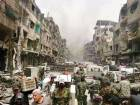 In this file picture irregular Syrian troops loot war-ravaged areas of the Yarmouk camp in Damascus.