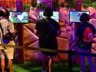 Gaming fans play the game 'Fortnite' at the 24th Electronic Expo