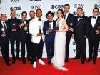 Cast and crew of 'The Band's Visit' pose in thepress room with the award for best musical atthe 72nd annual Tony Awards.
