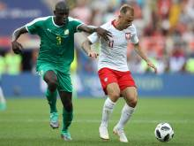 Super Senegal silence poor Poland in Moscow