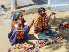 A Wada Koli woman and her daughter sell their bead and mirror work dolls in Nirona village