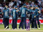England players celebrate after they overpowered Australia in the third one-dayer at Trent Bridge on Tuesday to wrap up the series. England posted 481 for six and won by 242 runs.