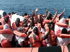 Migrants waving onboard an Italian coastguard ship. French rescue boat Aquarius carrying migrants on its way to Spain.