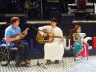 Emiratis Mohammad Al Aidrose (centre), and Aisha Arif (right) on stage with Mike Ballard during a programme to mark World Music Day at World Trade Centre, Abu Dhabi.