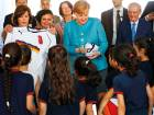 Angela Merkel distributes shirts of the German national soccer team to Lebanese and Syrian displaced students during her visit to a Lebanese public school in Beirut on Friday.
