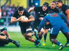 New Zealand's Codie Taylor, left, makes a run against France in the rugby test in Dunedin, New Zealand, Saturday, June 23, 2018.