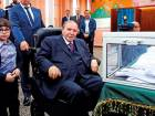 Bouteflika after casting his ballot during the election last year. The wheel-chair bound president has not said if he plans to run again.