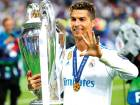 In this Saturday, May 26, 2018 file photo Real Madrid's Cristiano Ronaldo celebrates with the trophy after winning the Champions League Final soccer match between Real Madrid and Liverpool at the Olimpiyskiy Stadium in Kiev, Ukraine.