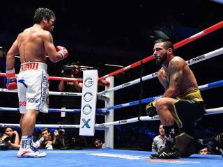 Pacquiao wins back world title