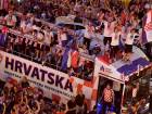 """Croatian national football team players ride a bus as people gather for a """"heroes' welcome"""" in tribute to their national team, after reaching the final at the Russia 2018 World Cup, at the Bana Jelacica Square in Zagreb."""