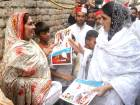 Pakistan Tehreek-e-Insaf- Gulalai (PTI-G) chief Ayesha Gulalai distributing leaflets during her door to door election campaign at 100 Quarters F-6-2.