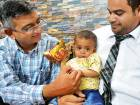 Hamad with his father Mohammad Raheem (right) and Dr Kaiser Raja of Aster Hospital at thefamily's home in Al Shamkha in Abu Dhabi. Hamad has gained weight since the transplant.