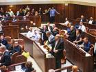 Palestinian lawmakers stand up in protest during a Knesset session in Occupied Jerusalem yesterday. Israel's parliament approved controversial legislation that defines the country as the nation-state of the Jewish people.