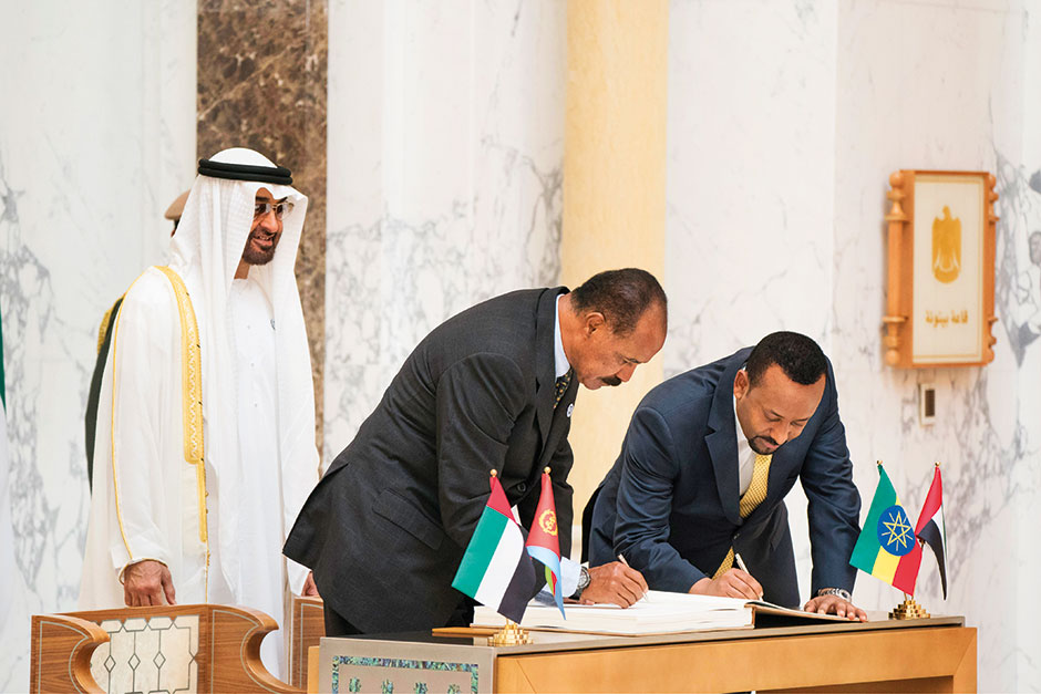 The prime minister of Ethiopia and president of Eritrea sign the visitors book.