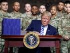 President Donald Trump signs the $716 billion defense policy bill named for Sen. John McCain at Fort Drum, N.Y., Monday, August 13, 2018.