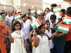 The students of Indian schools in Abu Dhabi wave the national flags during the flag hoisting ceremony to celebrate the 71st Anniversary of the Independance Day of India.
