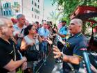 Some of the more than 500 evacuated residents from a dozen apartment buildings located under the severed ends of the Morandi motorway bridge, listen to a rescue official in Genoa, as they wait to get into their homes to collect their belongings amid fears that more debris could fall.