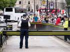 The area is packed with tourists as police secure the scene near a road barrier outside the Houses of Parliament in London, the day after a suspected terror attack.
