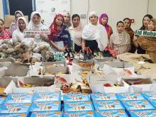 Society distributes Eid gifts to workers