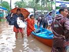 Flood victims are evacuated to safer areas in Kozhikode, in the southern Indian state of Kerala, Thursday, August 16, 2018.