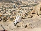 A muslim pilgrim prays while she climbs the Mount Al-Noor, where Muslims believe Prophet Mohammad received the first words of the Koran through Gabriel in the Hera cave, ahead of annual Haj pilgrimage in the holy city of Mecca, Saudi Arabia.
