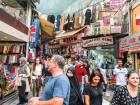 Shoppers at a market in Istanbul. The lira closed a volatile week at just over six to the dollar, off the lows of over seven earlier in the week, but still sharply down from the start of the month.