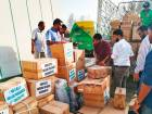 KMCC volunteers in Dubai packing donated material to be distributed among flood victims.
