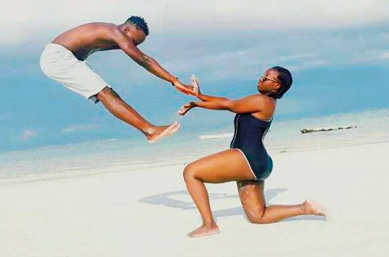 jump-for-joy-siblings-leon-and-winnie-at-the-diani-beach-a-popular-destination-for-tourists-lookin