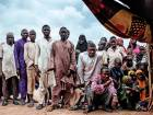 People gather outside a tent in one of the IDP (Internally Displaced People) camps in Pulka.