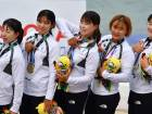 Members of the Unified Korea team pose on the podium after receiving their bronze medals during a medal ceremony for the women's canoe 200m traditional boat race at the 2018 Asian Games in Palembang on August 25, 2018.