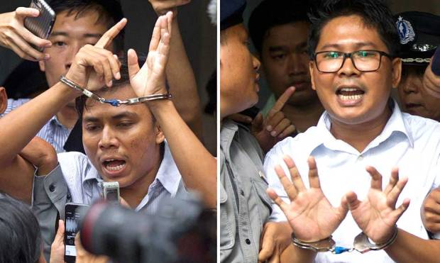 Pictures: Reuters reporters sentenced to jail