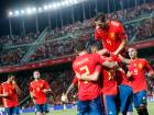 Spain's Sergio Ramos celebrates with teammates after scoring his side's fifth goal.