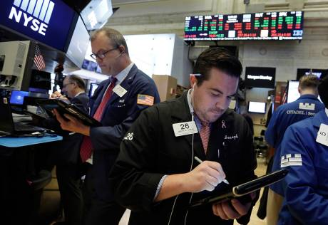 Wall St to open flat as trade worries linger
