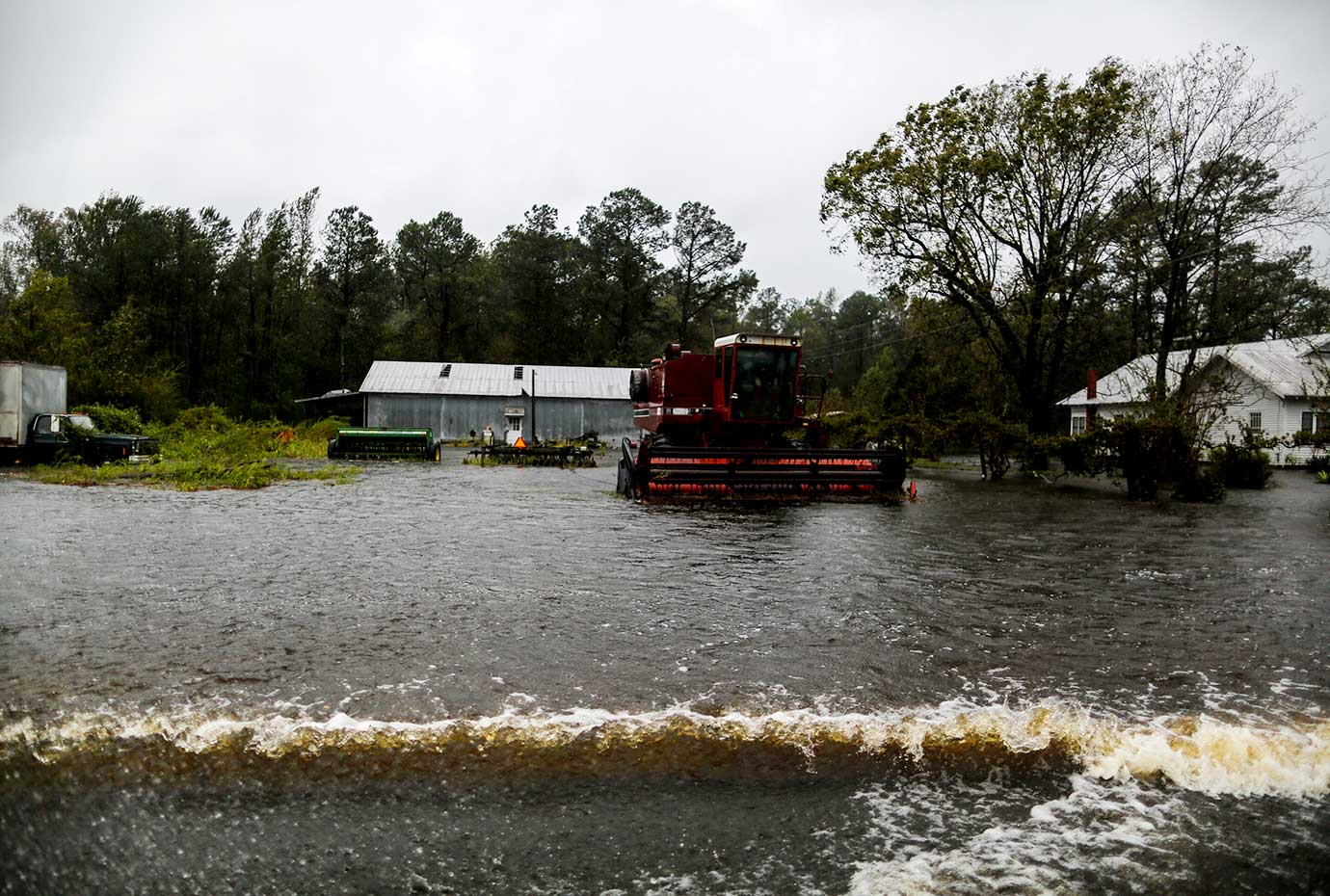 Water flows along open field in a local farm after Hurricane Florence swept the town of Wallace, Nor