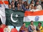 In this file photo taken on January 13, 2006 cricket fans hold Pakistani and Indian flags during the first day of their first Test match at the Gaddafi Cricket Stadium in Lahore. Sparks generally fly when India take on Pakistan at cricket, and the September 19, 2018 Asia Cup clash in Dubai will be an emotionally charged fixture as always.