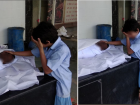 """This boy walked up to the body of his father, a poor labourer known as a """"manual scavenger"""", at a crematorium. He moved the sheet from the face, held the cheeks with both hands...uttered """"Papa"""" and began sobbing. The man died in a New Delhi sewer on Friday. And the family did not have money even for cremating him."""
