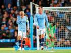 Manchester City's David Silva and Aymeric Laporte look dejected after losing to Olympique Lyonnais during a Champions League at the Etihad Stadium.
