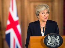 UK's May facing resignations over Brexit plan