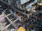 Members of the National Disaster Response Force (NDRF) search for victims after a building collapsed in New Delhi on September 26, 2018.