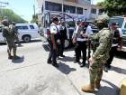 Mexican Marines escort municipal police officers disarmed and detained during an operation to check if they colluded with organised crime, in Acapulco, Mexico.