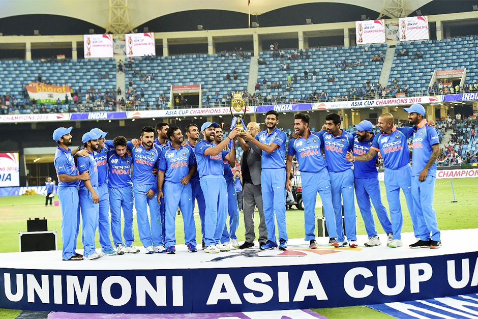 Indian players celebrate with the trophy after winning the Asia Cup final cricket match against Bang