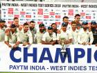 Team India pose with the trophy after winning the second Test against West Indies in Hyderabad.
