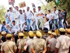 Congress party workers standing on police barricades shout slogans against India's junior external affairs minister M.J. Akbar during a protest in New Delhi, on Monday.