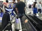 Teotronico robot playing piano during the Gitex Technology Week.