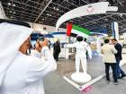 A visitor takes a picture of a robot at the Government of Abu Dhabi's pavilion at Gitex Technology W
